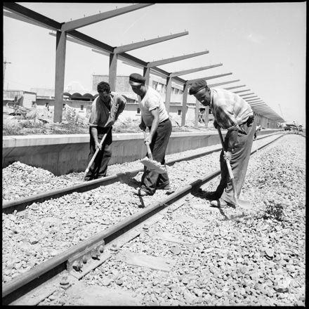 """Fifteen Miles To Go"" [Men working on railway tracks]"