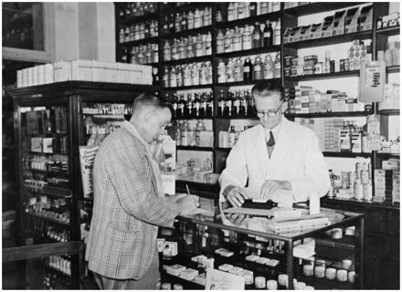 Evans Family Collection: Mr Evans in a Palmerston North pharmacy