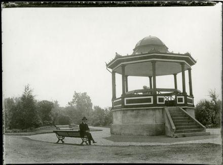 Man Sitting by Rotunda in Victoria Esplanade