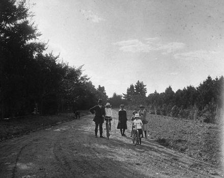 Family walking and biking on Victoria Drive, Victoria Esplanade