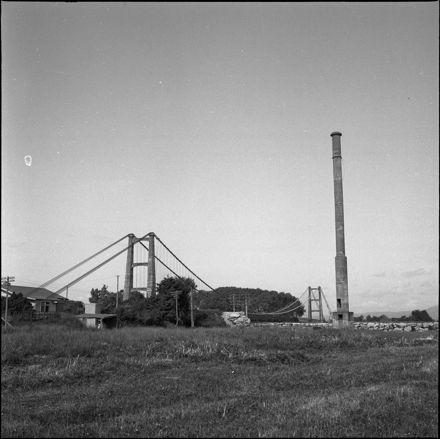 Opiki suspension bridge and old mill chimney, Rangitāne