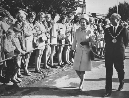 Queen Elizabeth II and the Mayor walk through The Square