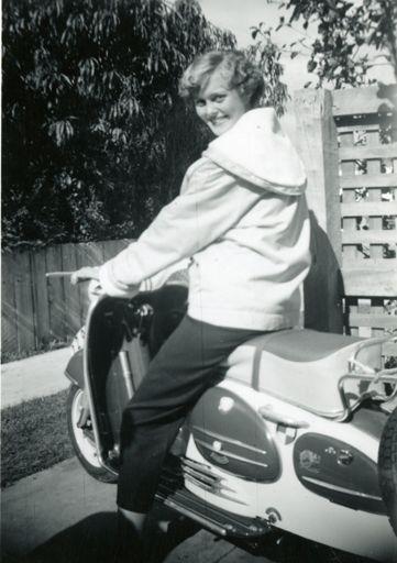 Pamela Burman on her motor scooter, Pahiatua Street