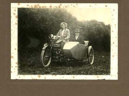 Couple on Motorcycle with Sidecar