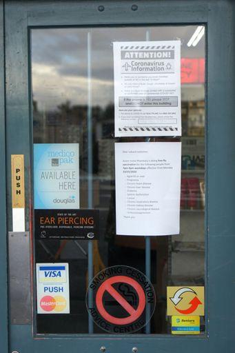 COVID-19 Sign - Grant Irvine Pharmacy