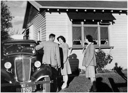 Evans Family Collection: Jack and Betty Evans leaving for a social evening with friends