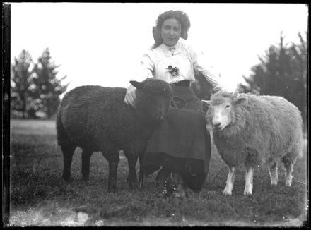Young Woman with Pet Sheep