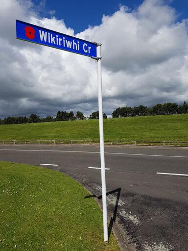 Wikiriwhi Crescent street sign with poppy