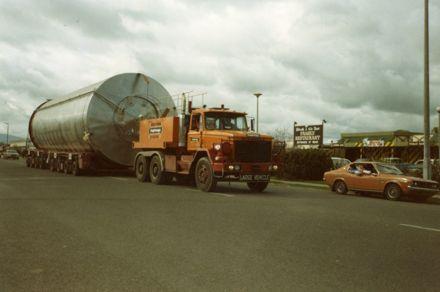 Truck towing vat on trailer