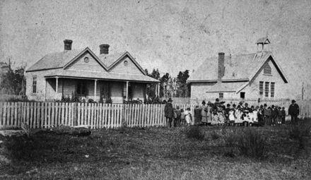 Pupils and adults outside Newbury School