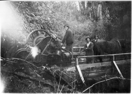 Workers with a steam driven 'log-hauler' in the bush