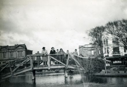 Group on lakelet bridge, The Square
