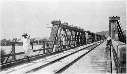Woman and boy on the Ngawapurua rail - road bridge