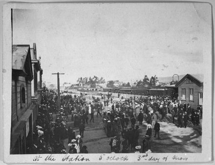 Crowds outside Palmerston North Railway Station, Main Street
