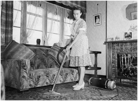 Evans Family Collection: Mrs Evans vacuuming the living room, 5 Mansford Place