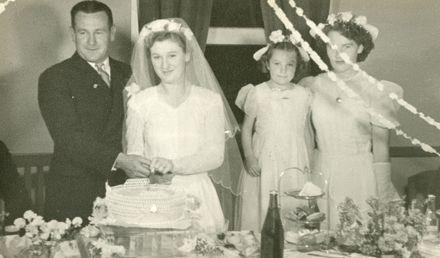 Cutting the cake at Barbara and Tom O'Grady's wedding