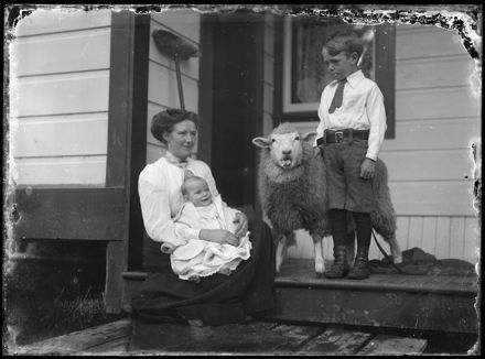 Woman and Children with Pet Sheep