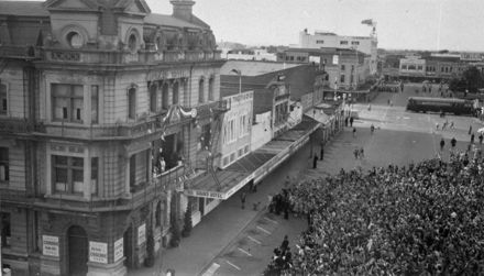Queen Elizabeth II waving to crowds from the Grand Hotel