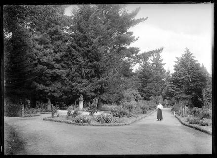 Woman Walks through Garden