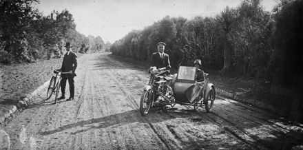 Cycle and motor bike with sidecar on Victoria Drive, Victoria Esplanade