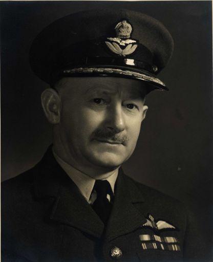 Group Captain T. W. White