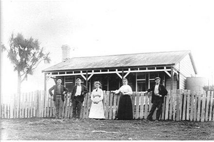 Brown Family in front of house, 1906