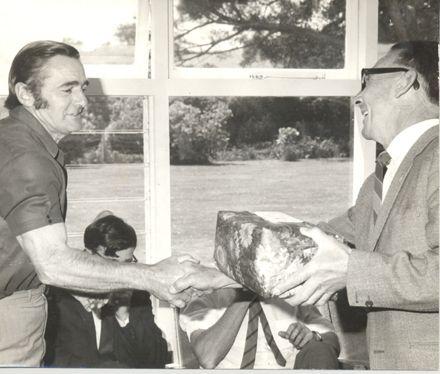 Presentation of gift with handshake