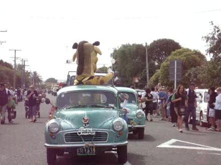 Old Morris car with Harold the Clown at Levin Christmas Parade 2011