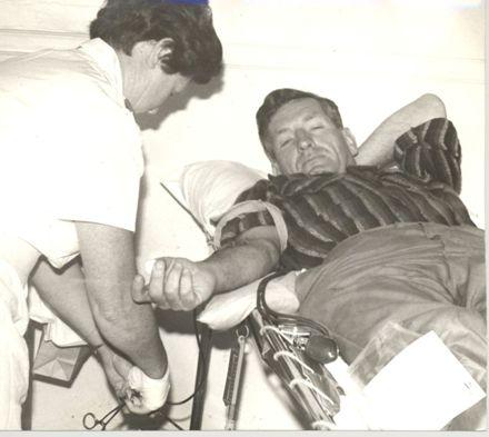 Man (unidentified) donating blood