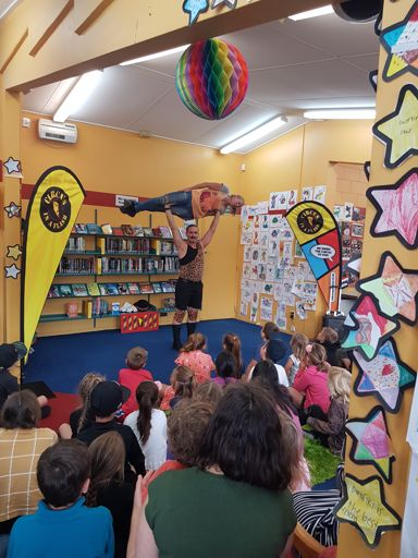 Strong Man Stan performs at Awapuni Library