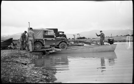 """""""Versatile Engineers Show Their Paces"""" - Army Engineers Loading Landrover onto Raft"""